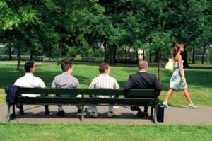 Woman walking past park bench